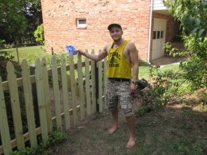 Me standing by the finished fence